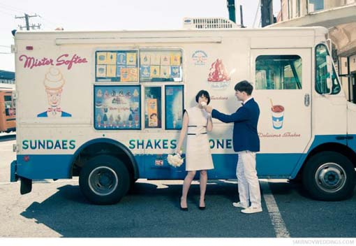 vintage-bride-and-groom-eat-ice-cream-in-front-of-vintage-ice-cream-truck-downtown-philly-wedding